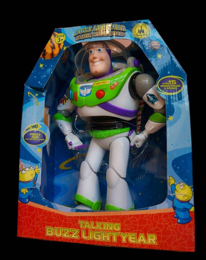 Buzz Lightyear Toy i lådan, isolerad på svart royaltyfri fotografi
