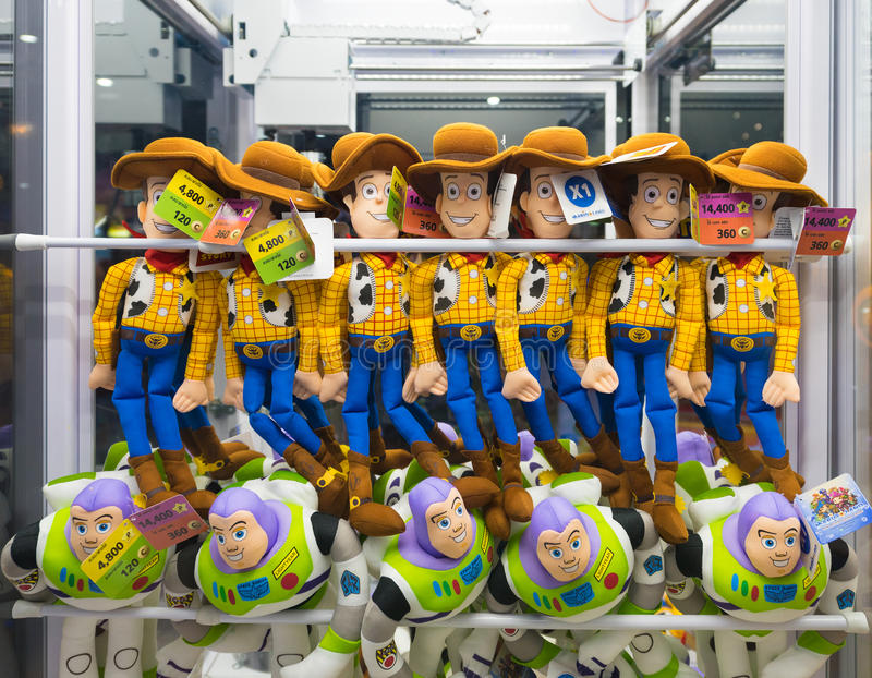 Buzz Lightyear and Woody toys on sale. BANGKOK - MARCH 16, 2016: Buzz Lightyear and Woody toys, Toy Story characters, are in a claw crane at MBK mall. Toy Story stock photo