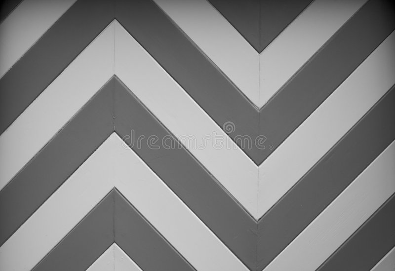 BW Chevron Garage door design. A black and white chevron or zig zag wood design of a garage door on an older home royalty free stock images