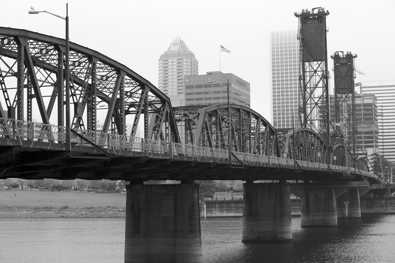 BW Foggy Hawthorne Bridge. Foggy day with a diminishing view of the Hawthorne Bridge on the Williamette River in Black and White royalty free stock photo