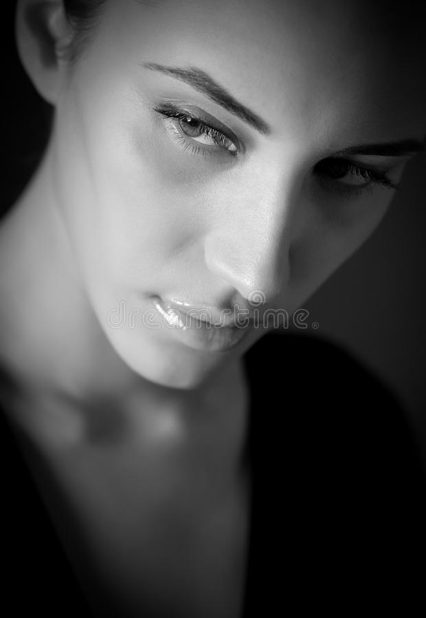 BW portrait of attractive melancholic girl