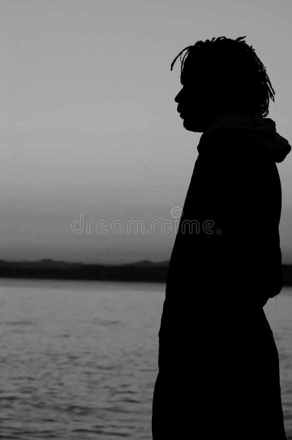 BW Profile of a man on seafront stock photo
