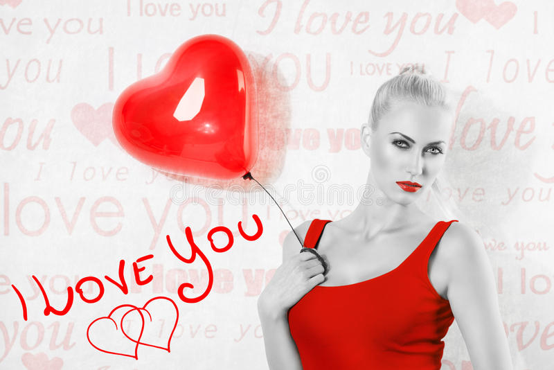 BW shot of blonde girl with heart balloon royalty free stock photography