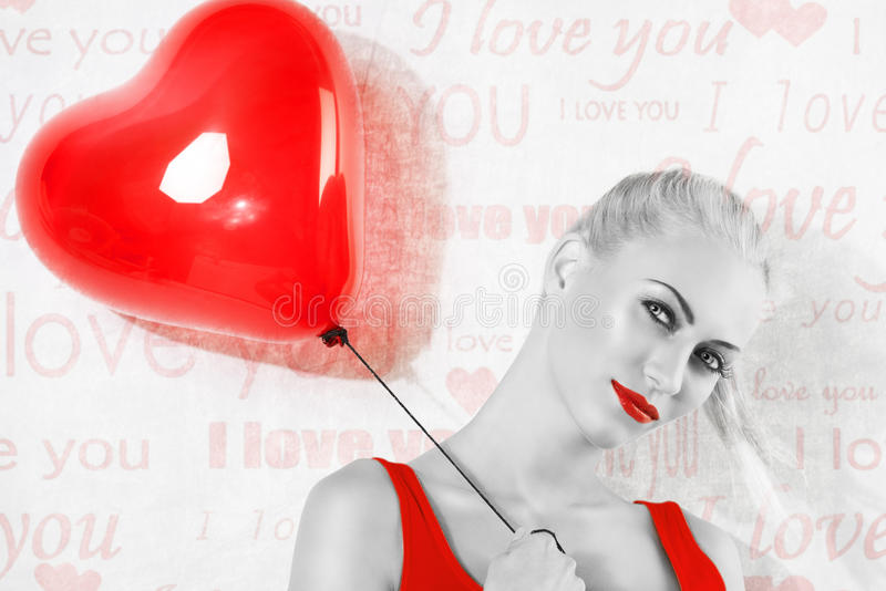 BW shot , of blonde girl with red heart balloon royalty free stock images