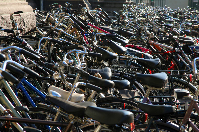 Hundreds of bikes on sidewalk. Hundreds of bikes parked on the sidewalk in Amsterdam stock photography