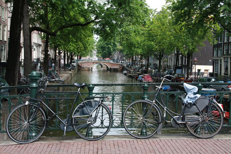Bycicles on a bridge in Amsterdam stock photography