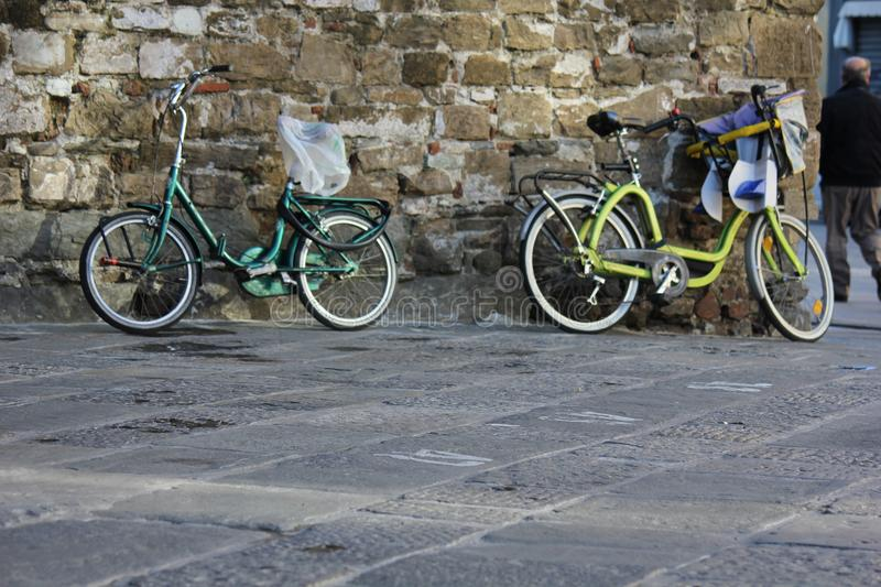 Bycicles on a wall in florence royalty free stock images
