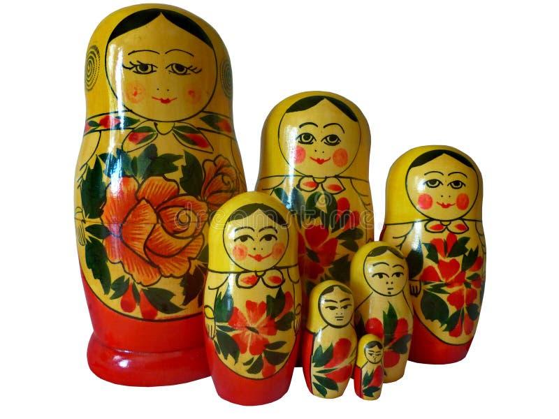Bygga bo dockor på en vit linnebordduk Bygga bodockor är de populäraste souvenirna från Ryssland Ryskt folkhantverk retro royaltyfria foton