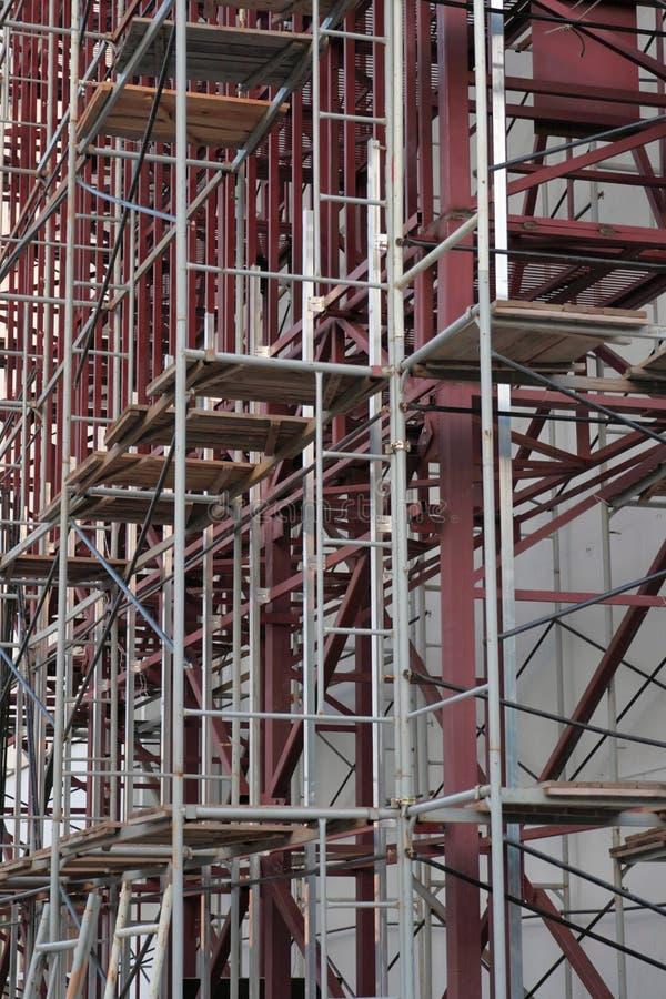 byggande mång- material till byggnadsställningstorey royaltyfria foton