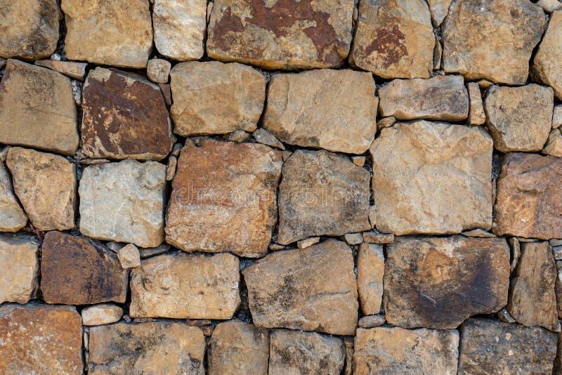 Byggd vägg för sten kvarter royaltyfri foto
