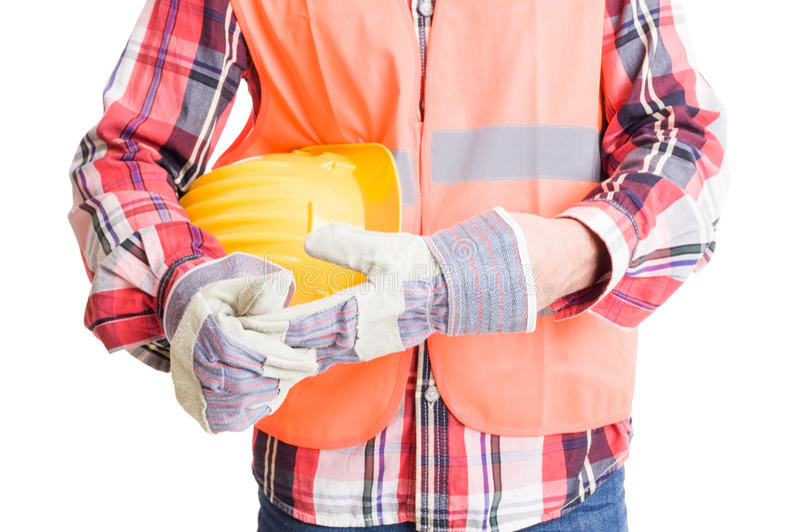 Byggmästare eller byggnadsarbetare som ut drar handsken royaltyfri bild