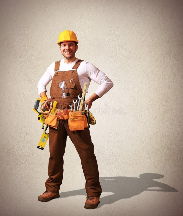 Byggmästare i gul hjälm arkivfoton