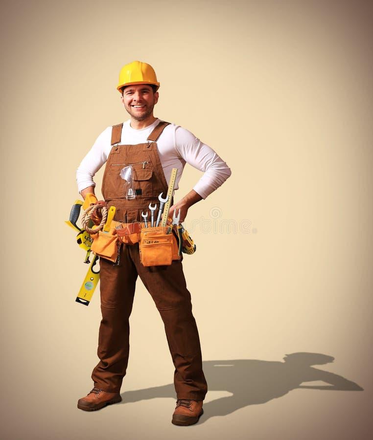 Byggmästare i gul hjälm royaltyfri fotografi