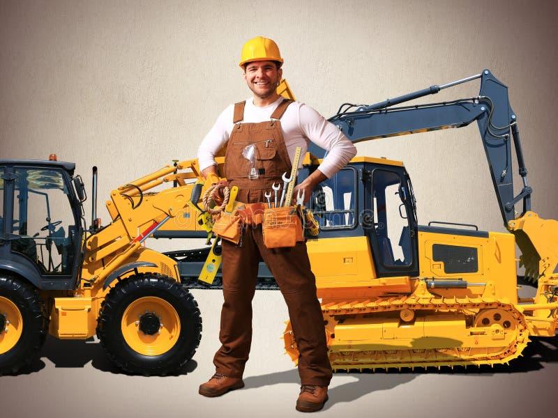 Byggmästare i gul hjälm arkivbild