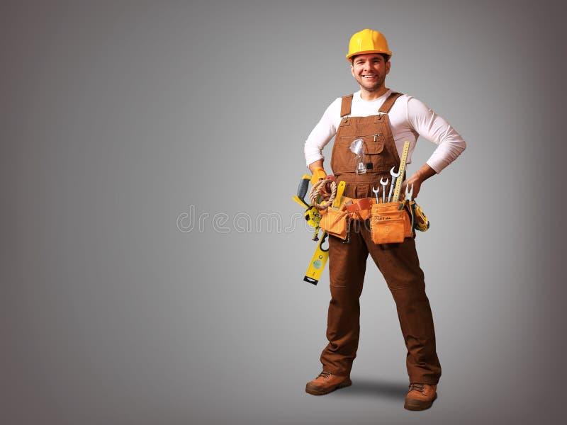 Byggmästare i gul hjälm arkivfoto