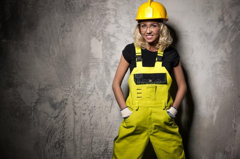Byggmästarekvinna arkivfoto