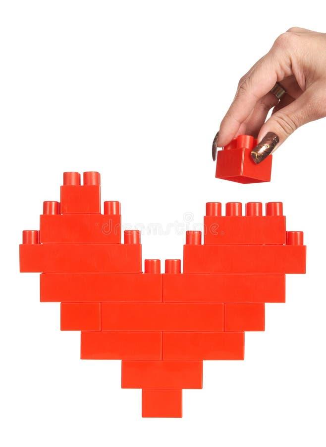 byggnad hands hjärtakvinnan arkivbild