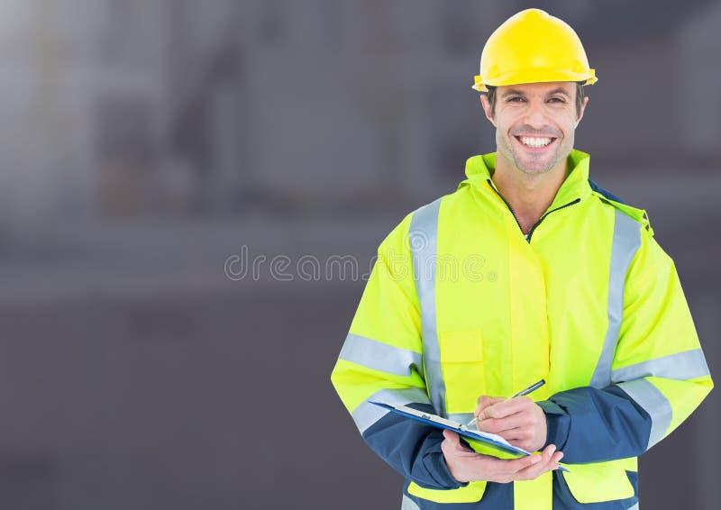 Byggnadsarbetare framme av konstruktionsplatsen royaltyfria foton