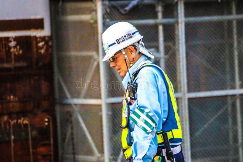 Byggnadsarbetare i Tokyo Japan royaltyfri foto