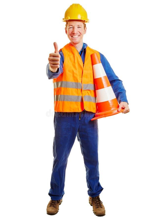 Byggnadsarbetare med en säkerhetsväst och en hjälm royaltyfria foton