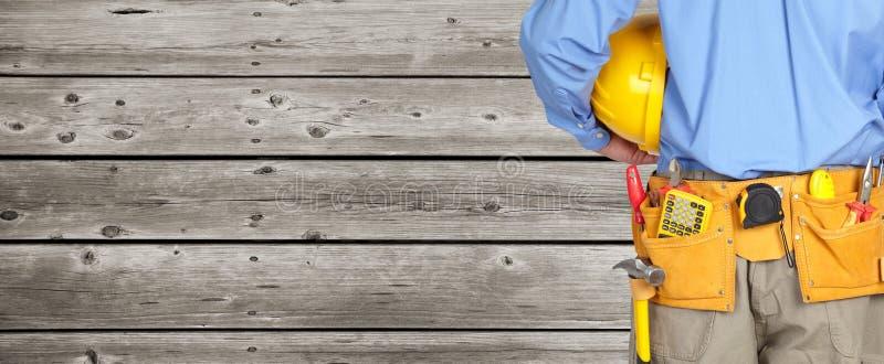 Byggnadsarbetare med ett hjälpmedelbälte arkivbilder