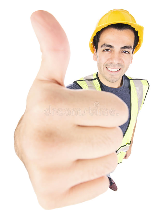 Byggnadsarbetare som ger upp tummar arkivbild