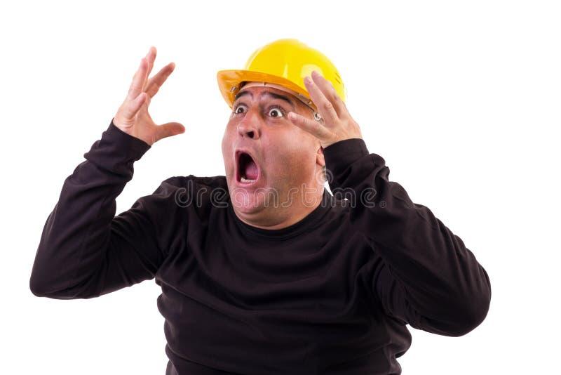 Byggnadsarbetare som skriker i skräck royaltyfria bilder