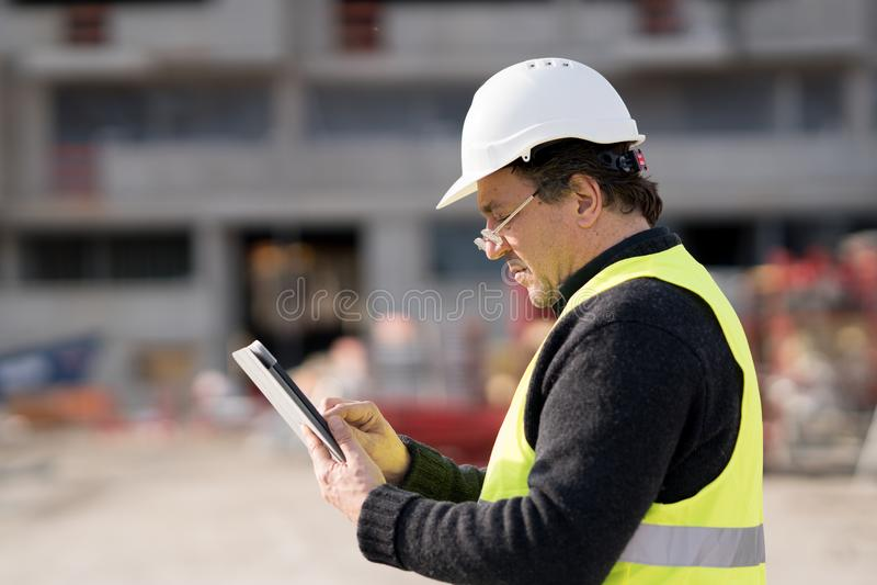 Byggnadsarbetare At Work arkivfoto