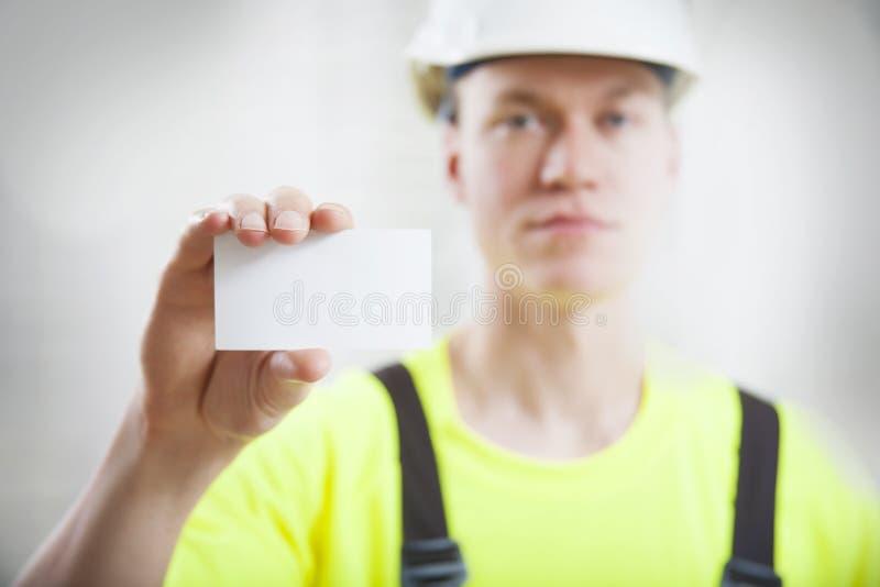 Byggnadsarbetareaffärskort royaltyfria foton