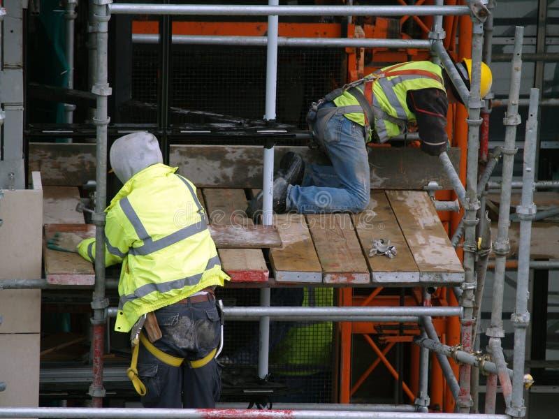 byggnadsarbetarear royaltyfri bild