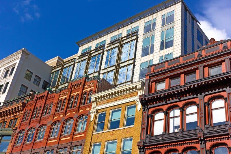 Byggnadsmosaik av historiska och moderna stilar i den i stadens centrum Washington DC, USA royaltyfri fotografi