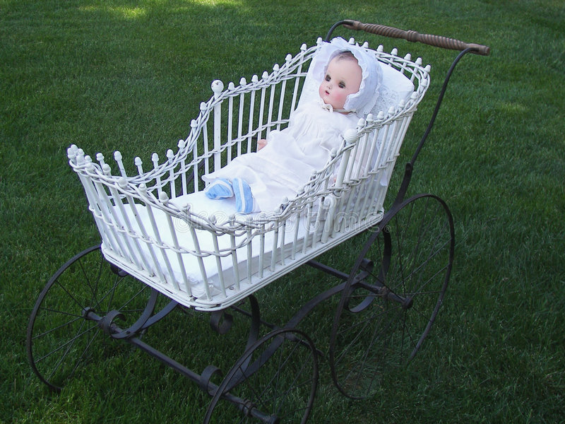 old doll in vintage buggy royalty free stock image