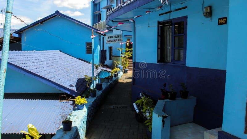 Byn Arema (blå by) inträde i malang, östra java arkivfoton