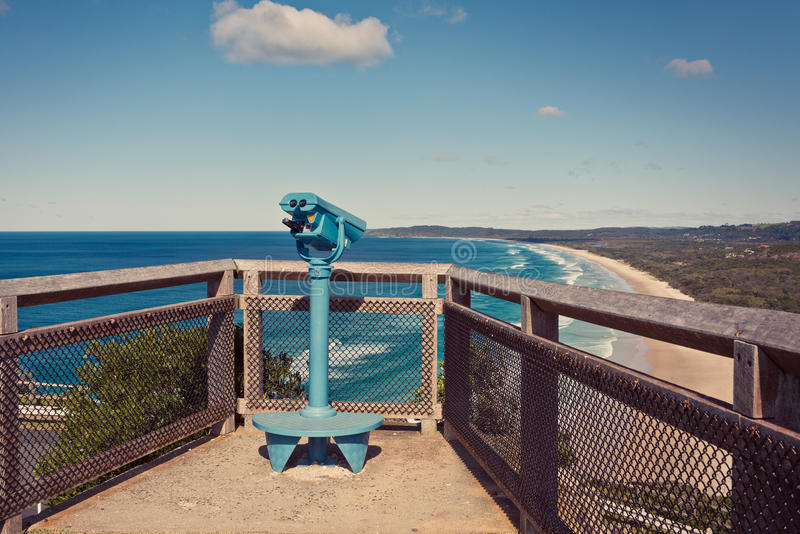 Byron bay lookout point. Binoculars overlooking the Gold Coast beaches and the ocean, on a cliff near byron bay lighthouse royalty free stock photos