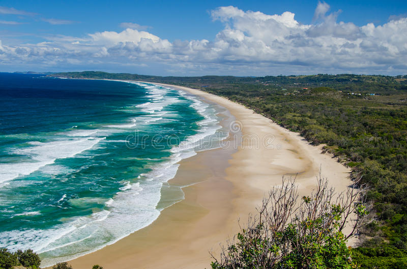 Byron Bay. View from the lighthouse at Cape Byron on a deserted beach royalty free stock images