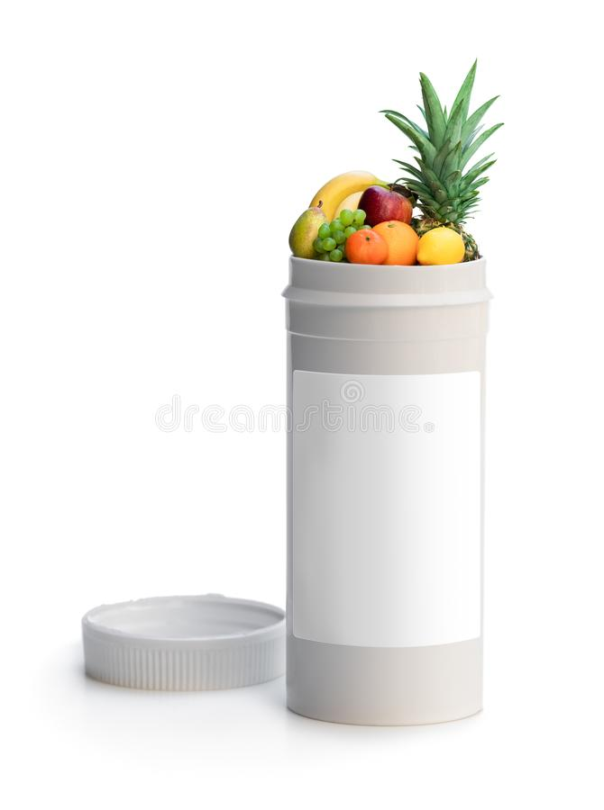 Byt dina piller till nya frukter Begreppet av naturen gjorde vitamintill?gget fr?n naturliga tropiska frukter fotografering för bildbyråer