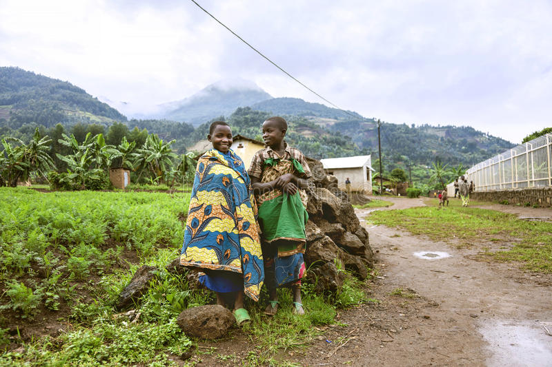 BYUMBA, RWANDA - SEPTEMBER 9, 2015: Unidentified kids. Two Rwandan children who wear traditional clothes. Two Rwandan children who wear traditional clothes royalty free stock photo
