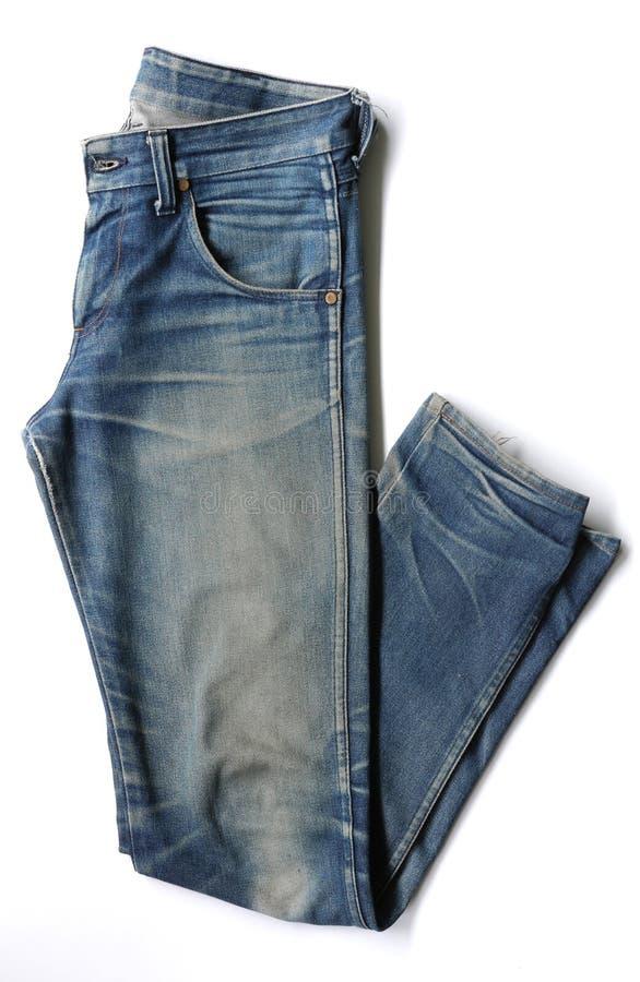 Byx- för jeans som isoleras på den vita bakgrunden med banan royaltyfri bild