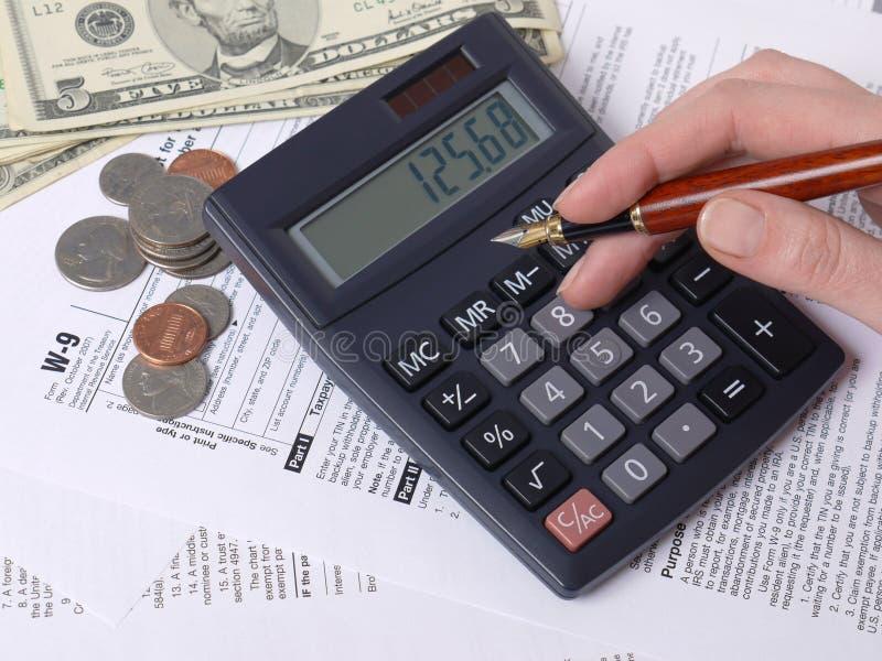 Cálculo do imposto fotos de stock
