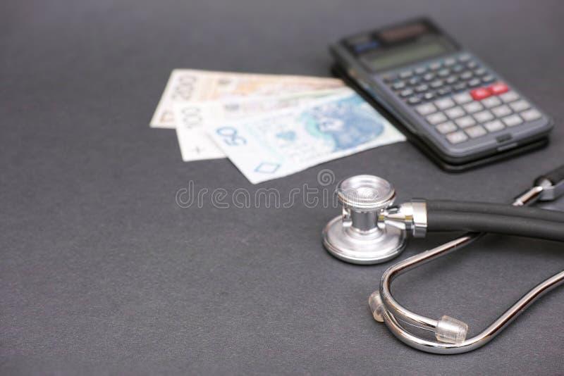 Cálculos polacos de la atención sanitaria imagen de archivo