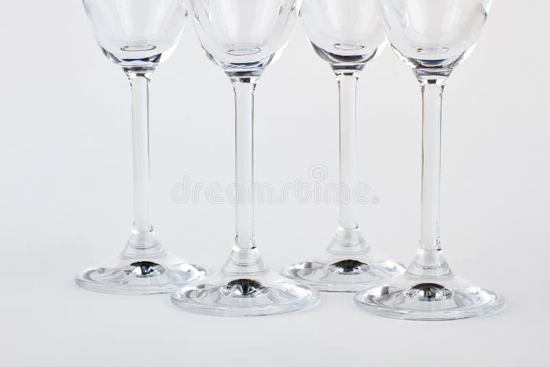 Cálices do champanhe do close up quatro foto de stock royalty free