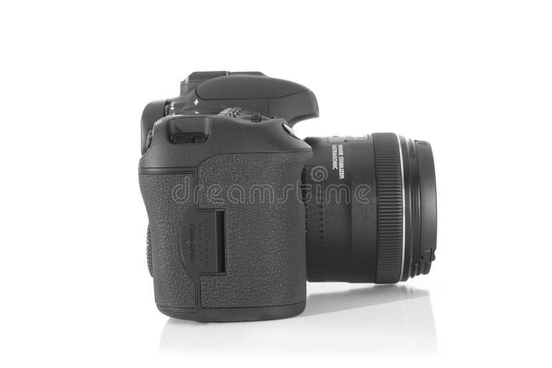 Cámara profesional de la foto de DSLR con una lente de 35 milímetros en el plexiglás fotos de archivo