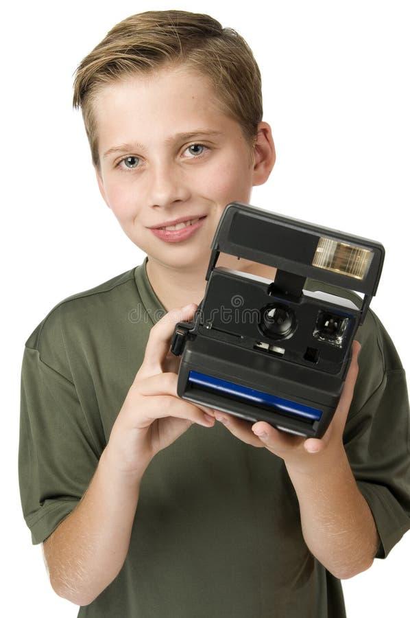 Cámara rápida de la demostración del muchacho foto de archivo