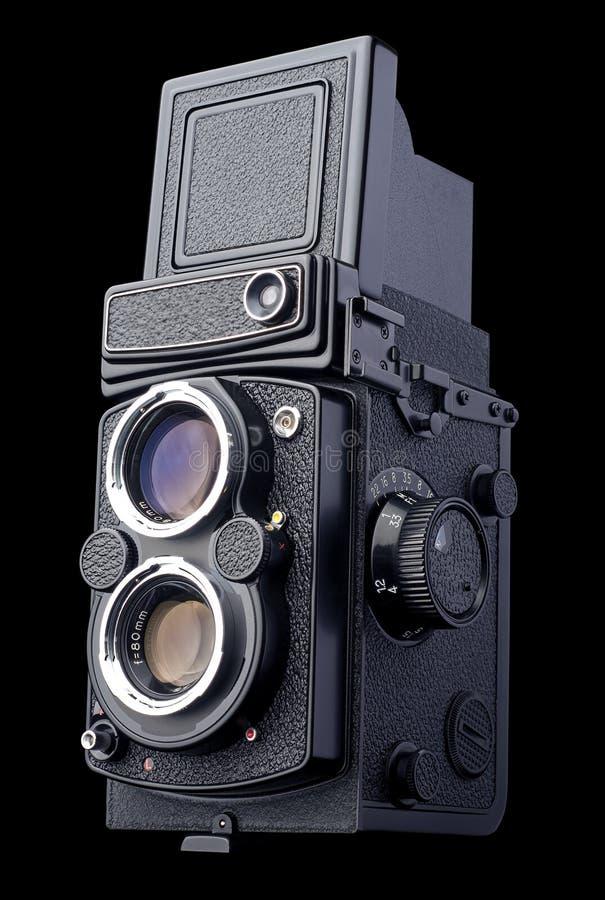 Cámara refleja de la película de la lente gemela antigua imagenes de archivo