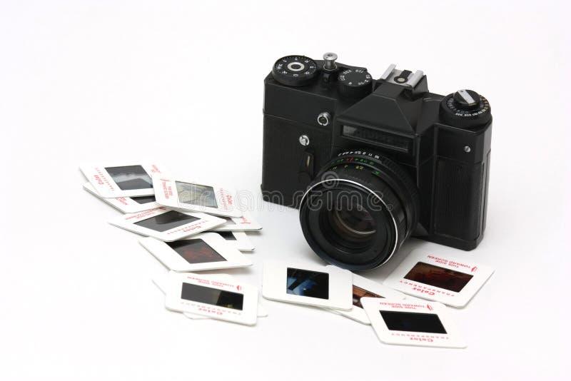 Cámara y diapositivas de la película foto de archivo