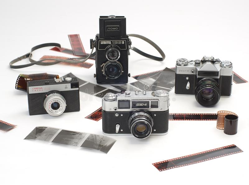 Cámaras viejas y películas fotográficas foto de archivo