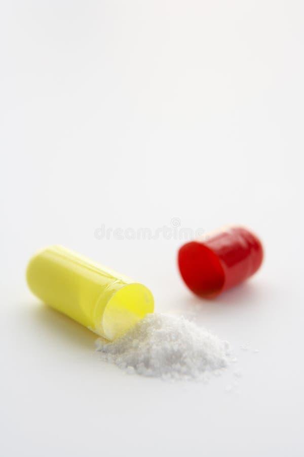 Cápsula medicinal abierta foto de archivo