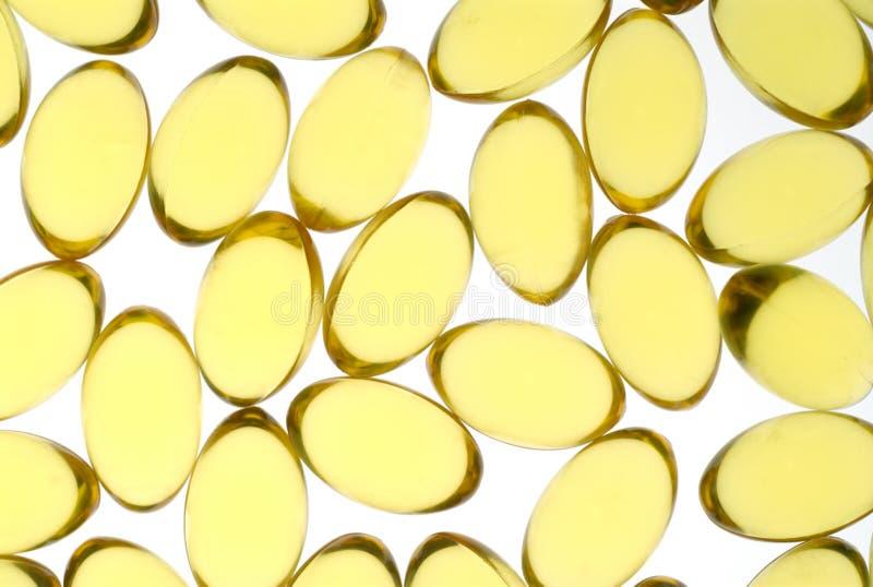 Cápsulas amarillas imagen de archivo