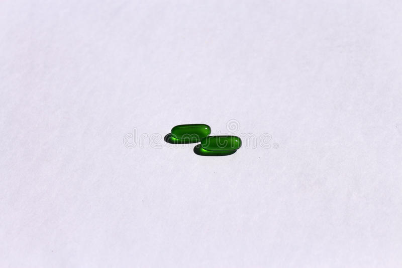 Cápsulas de la vitamina E imagenes de archivo