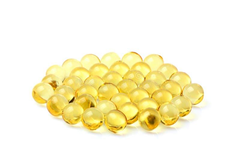 Cápsulas del aceite de pescado en la ronda foto de archivo libre de regalías